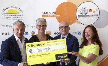 SMT Charity Scheck € 30.001